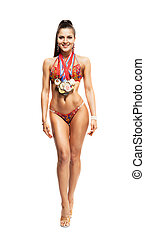 fitness bikini athlete with winning medals