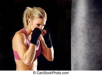 Fitness Boxing - Young woman fitness boxing in front of...