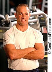 fitness center man - handsome man smiling in fitness center