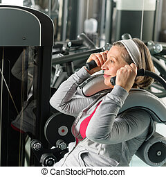 Fitness center senior woman exercise abs muscles - Fitness...