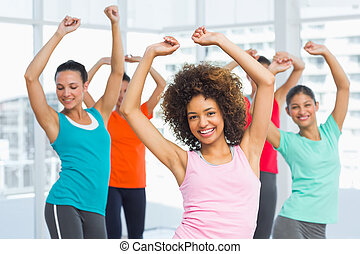 Fitness class and instructor doing pilates exercise - ...
