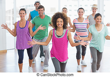 Fitness class and instructor doing