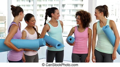 Fitness class chatting before their