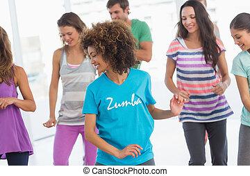 Fitness class doing pilates exercis