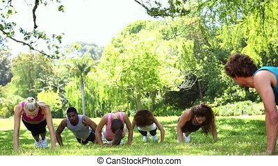 Fitness class doing push ups