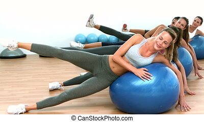 Fitness class exercising on on exer