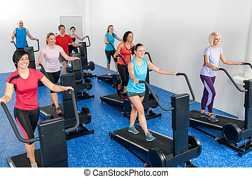Fitness class walking on treadmill running belt