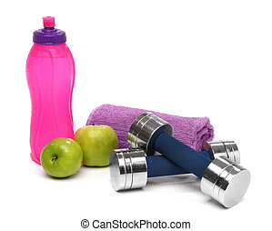 Fitness concept with a bottle of water, a towel, dumbbells and apples