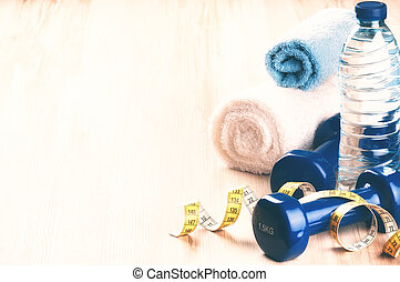 Fitness concept with dumbbells and water bottle. Health and sport background
