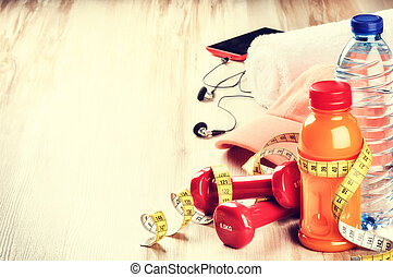 Fitness concept with dumbbells, fruits juice and water bottle