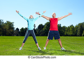 Fitness couple. - Happy senior fitness couple in the park.
