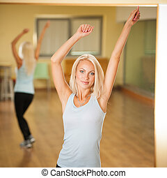 Fitness dance class aerobics. Women dancing happy energetic in gym fitness class