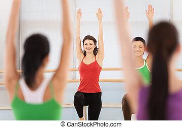 Fitness dance class doing aerobics. Women dancing happy energetic in gym fitness class.