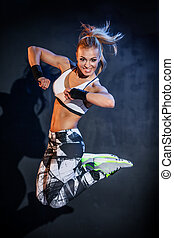 Fitness dancer - Young woman jumps while making aerobics ...