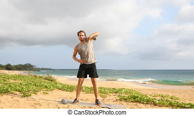 Fitness Dumbbell Snatch - man doing strength training fitness exercises with Dumbbells on beach. Fit male fitness model working out lifting free weights outdoors on beach.