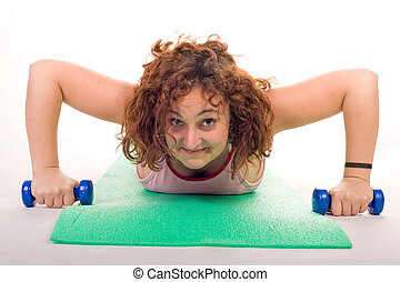 fitness efforts - woman making strong exercice on gym carpet