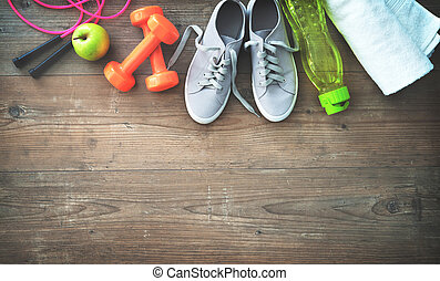 Fitness equipment, healthy food, sneakers, water bottle and towel