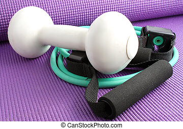 Fitness equipment - Yoga mat, free weight and stretchy band ...