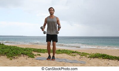 Fitness exercise Bicep Curls - fitness man exercising biceps with dumbbells arm curl on beach. Two-arm biceps curls workout by fit sport fitness model.