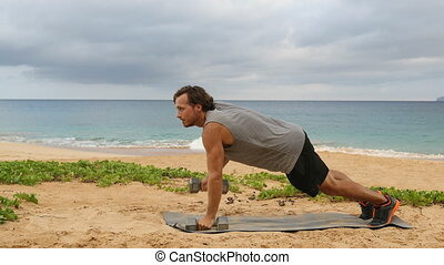 Fitness exercises Dumbbell Plank Row. Sport man doing Alternating Renegade Row exercise using dumbbells while exercising outside on beach. REAL TIME video.