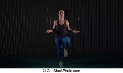 Fitness Female Doing Cardio With Jumping Rope - Sportswoman...