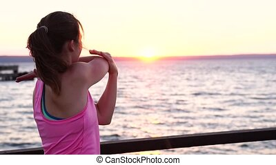 Fitness Female Practicing Exercises at Sunset