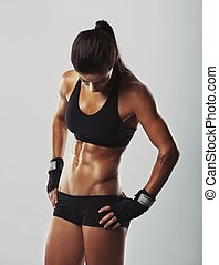 Fitness female resting after workout - Muscular young woman...