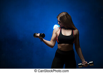 Fitness female working out with dumbbells