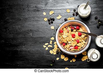 Fitness food. Muesli with ripe berries and milk.