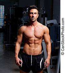 fitness, formé, homme muscle, poser, sur, gymnase