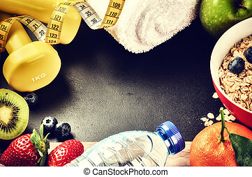 Fitness frame with dumbbells, water bottle and fresh fruits. Hea