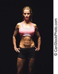 fitness, frau, freigestellt, auf, schwarzer hintergrund, anschauen, sie