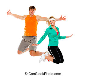 Fitness girl and man in sportswear jumping isolated on white...