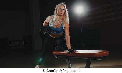 Fitness girl doing exercise in the gym
