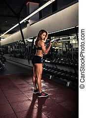 Fitness girl doing exercise with barbell