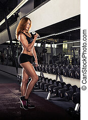 Fitness girl doing exercise with dumbbells