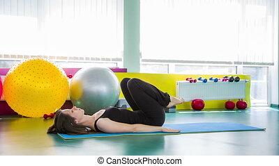 Fitness Girl Doing Gluteal Bridge Pose On The Floor