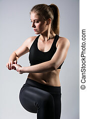 Fitness girl doing stretch exercise