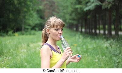 Fitness girl drinking water - Portrait of young beautiful...
