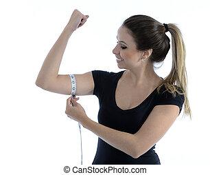 Fitness girl measuring her biceps - Pretty beautiful girl ...