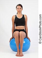 Fitness girl on exercise ball