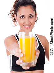 fitness girl showing a fresh juice, focus on girl