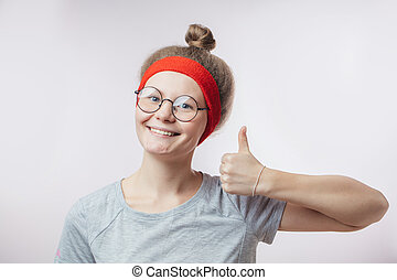 fitness girl showing super gesture.