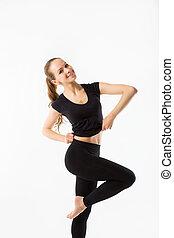 Fitness girl standing on one leg