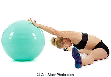 Fitness girl working with gym ball