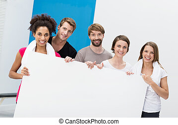 Fitness group at the gym holding a blank card