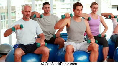 Fitness group sitting on exercise