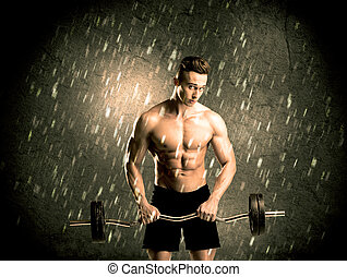 Fitness guy with weight showing muscles