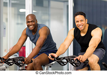 fitness guys biking in gym