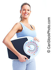 Fitness. - Healthy young woman with a weight scale. Isolated...